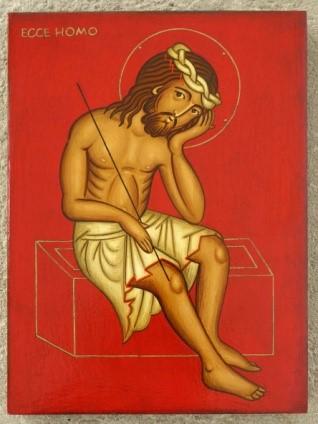 Jeesus istuu ja nojaa kämmeneensä.
