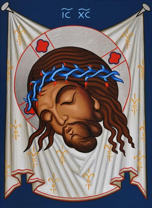 Nauloilla ripustettu liina, jossa Kristuksen kasvot.